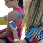 Custom body painting from design on teens phone, Seagull pic with caption Live Free